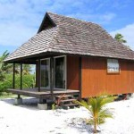 Wooden bungalow on white sand beach